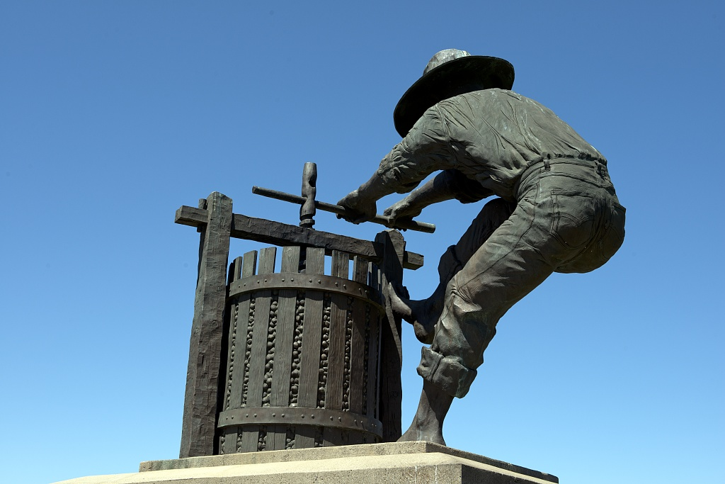 Statue of a worker at a wine press in Napa Valley, California