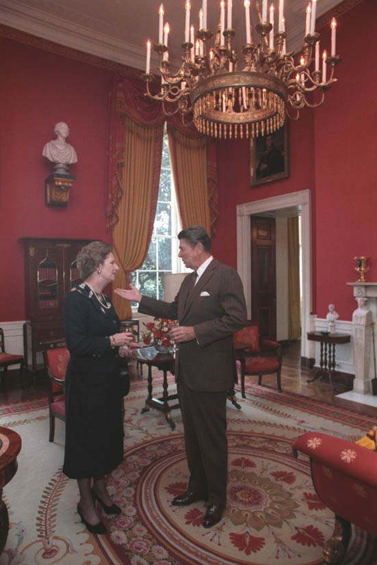 Ronald Reagan and Margaret Thatcher enjoying a glass of wine