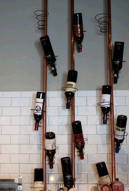 Wine rack made from copper pipes and bed springs