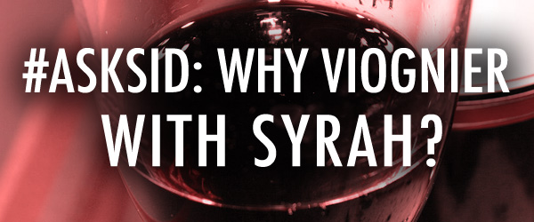Why do some Syrah wines have a mix of Viognier?