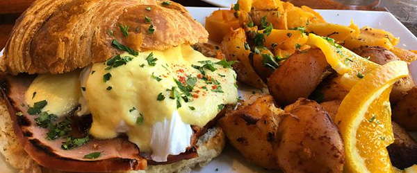 Croissant eggs Benedict sandwich brunch